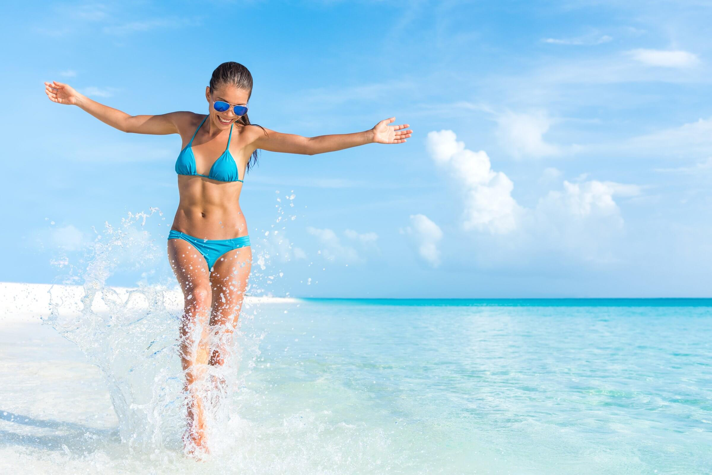 Feminine Rejuvenation Treatments include the O-Shot and V-Lase - Body Rejuvenation Treatments include Body Sculpting without surgery the list of services at slatermd.com is endless. The graphic shows a beautiful woman running on the beach